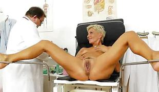 Granny lets mature doc gape her pussy