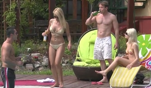 Two tanned blonde Euro babes fucking apart from the pool