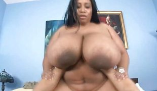 Monstrous tits ebony fatty welcomes big white cock