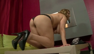 Appetizing and yummy woman with large natural pair gets naked and masturbates