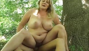 Chubby busty mature blonde gets hardcore fucked in the woods