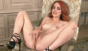 Red-haired babe Amarna Millere in swart high heels is a grouchy girl with real breasts who loves rubbing her pink pussy. She moans and groans during pussy fingering. Hot solo porn!